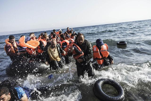 Syrian refugees arriving on the shores of the Greek island Lesbos in an inflatable boat from Turkey last month. PHOTO: AGENCE FRANCE-PRESSE